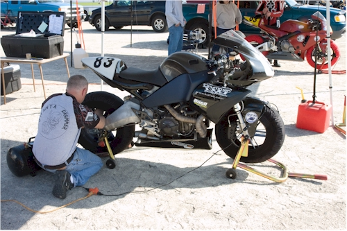 Kevin Drum works on Eric Ashbaugh's race bike.